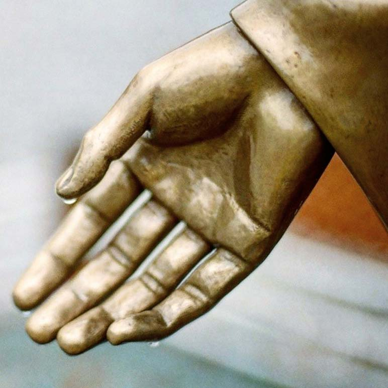 Close up of one of the hands of the Jesus bronze statue in Wolmyeongdong