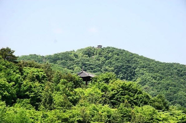 Two pavilions that are connected by a hiking trail from Wolmyeongdong